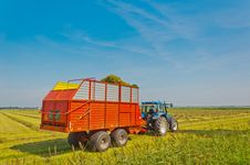 Free Collecting Grass With Tractor And Silage Wagon Stock Image - 20585091