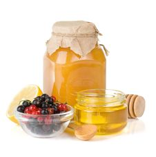 Glass Jar Full Of Honey, Lemon And Berry Royalty Free Stock Photo