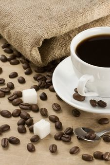Cup Of Coffee And Beans At Sacking