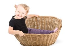 Beautiful Little Girl In Basket Stock Images
