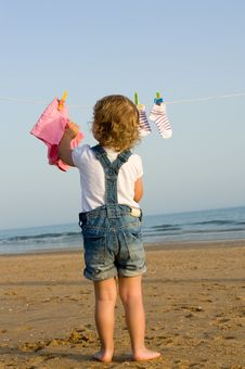 Little Girl Hung Laundry On The Sea Royalty Free Stock Photo