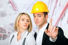 Male Female Architects Pointing Stock Images