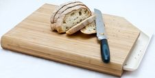 Free Bread And Knife On A Cutting Board Stock Photography - 20589412