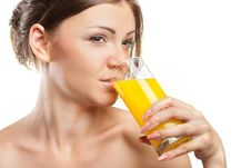 Free Young Beautiful Woman Drinking Orange Juice Stock Photography - 20589612