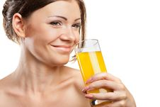 Free Young Beautiful Woman Drinking Orange Juice Royalty Free Stock Photos - 20589618
