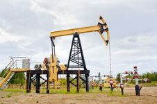 Pump Jack And Oil Well. Stock Photos