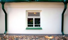 One Square Window, Two Downspouts Stock Image