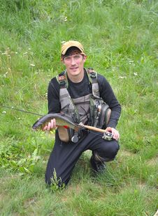 Free Fly Fisher With Chub Stock Image - 20594561
