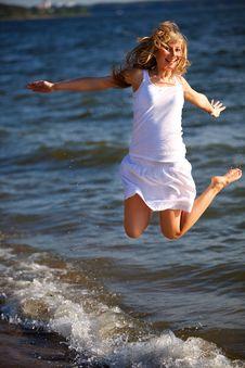 Free Happy Woman Jumping On The Sea Beach Stock Photos - 20597843