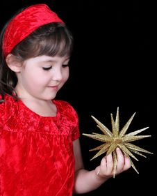 Free Cgirl In Christmas Dress Holding Gold Star Stock Photos - 20598213