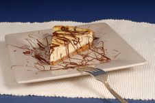 Free A Piece Of Cheesecake With Chocolate Drizzled Over It Stock Photography - 2060392