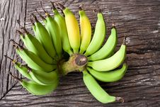 Free Butch Of Small  Bananas On Old Wood Table Stock Photography - 20600452