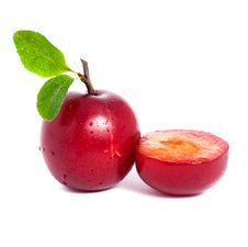 Free Fresh Plum And A Half With Leafs Stock Photo - 20602380