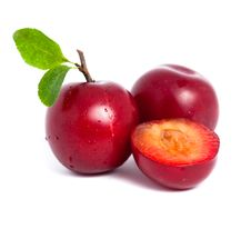 Free Two Fresh Plums And A Half With Leafs Royalty Free Stock Photo - 20602385