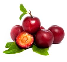 Free Pile Of Fresh Plums With Leafs Royalty Free Stock Photos - 20602388