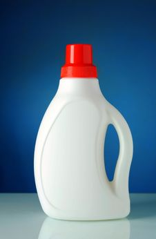 Free Bottle Of Detergent On A Blue Background Royalty Free Stock Photography - 20604597