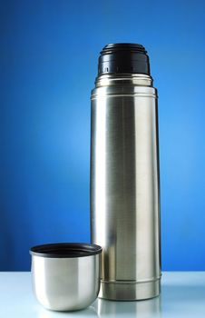 Free Thermos Silver On A Blue Background Stock Image - 20604601