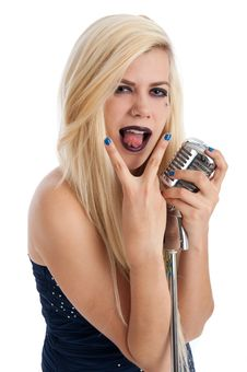 Beautiful Blonde Female Singer In Blue Dress Stock Photography