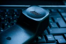 Blue Toned Phone Receiver On Keyboard Stock Image