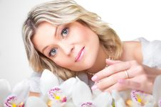 Free Blonde Woman With Orchid On White Stock Photography - 20607152
