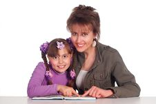 Mom Reads With Daughter Royalty Free Stock Photos