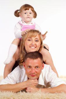Free Cute Family On Carpet Royalty Free Stock Photos - 20610308