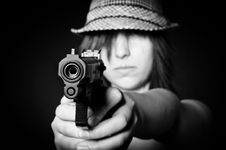Free Girl In Hat With A Big Pistol Royalty Free Stock Photography - 20610607