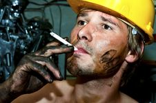 Worker Covered In Oil Stock Photography