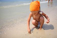 Cute Girl Playing With Beach Toys Stock Images
