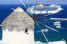 Free Huge Cruise Ship And A Windmill In Mykonos Royalty Free Stock Photo - 20611695