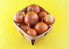 Free Onions In Box On Yellow Background. Royalty Free Stock Photography - 20614637
