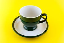 Empty Cup On Yellow Background. Stock Image