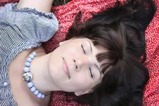 Free Attractive Girl, Lying On A Travelling Rug Royalty Free Stock Photos - 20617018