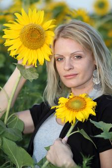 Beauty Woman And Sunflowers Royalty Free Stock Photography