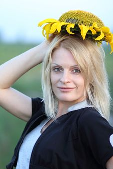 Beauty Woman And Sunflowers Stock Image