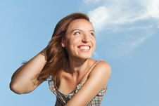 Free Beautiful Young Woman Smiling Against The Sky Royalty Free Stock Photos - 20621608