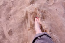 Woman S Foot In Soft Sand Stock Photos