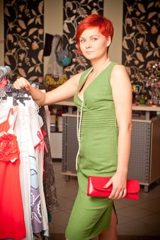 Free Young Woman Choosing Dress Stock Photography - 20625552