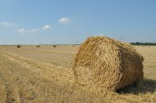 On The Sloping Field Of Wheat Is A Big Stack Of Straw Royalty Free Stock Photography