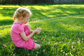 Free Young Girl In Pink Picking Up Flowers In A Field Stock Images - 20637534