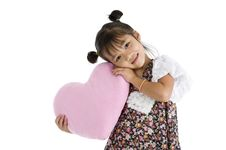 Free Girl With Heart Shaped Pillow Stock Photography - 20634942