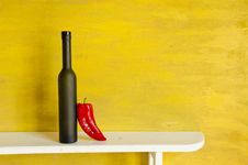 Free Black Bottle And Red Pepper Royalty Free Stock Image - 20637476