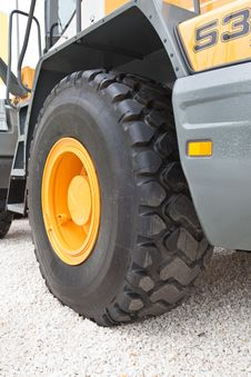 Black Wheel With Yellow Disk Of Front Loader Royalty Free Stock Images