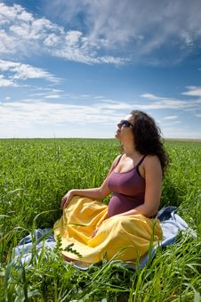 Pregnant Woman On Green Grass Field Under Blue Sky Royalty Free Stock Photos