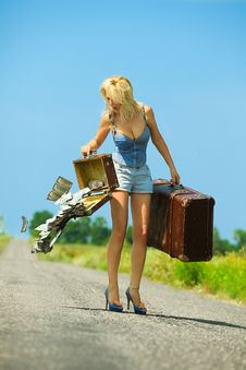 Woman Holding  Opening Suitcases With Cash Royalty Free Stock Photography