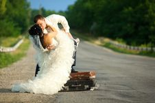 Free Newlywed Couple Kissing On A Road Royalty Free Stock Photography - 20639797
