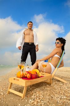 Free Couple Resting On The Beach Royalty Free Stock Photography - 20639807