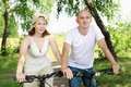Free Young Couple On The Bikes In The Park Stock Photos - 20643723