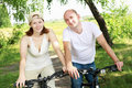 Free Young Couple On The Bikes In The Park Stock Photo - 20643830