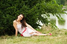 Beautiful Attractive Woman Sitting On A Grass Royalty Free Stock Image
